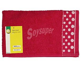 Productos Económicos Alcampo Toalla 100% algodón color rosa fucsia con cenefa estampada Topos para tocador, densidad de 360 gramos/m², 30x50 centímetros 1 unidad