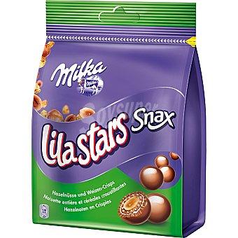 Milka Lila Stars Snax. Bolitas de chocolate con leche con avellana entera y cereales crujientes Bolsa 150 g