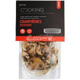Eroski Champiñones estofados al ajillo sobre 100 g